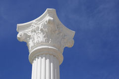 Column and capital. White lonely column and capital against the dark blue sky Royalty Free Stock Images
