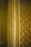 Column capitals  covered with gold leaf religion Royalty Free Stock Photography