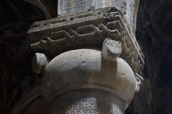 Column with cat heads decoration in medieval christian church Stock Photo