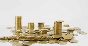 A column of coins goes down. Financial risk. Investments and accumulation. Financial insurance. Columns from ukrainian coins stock video