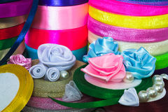 Сolored ribbons. Column colored ribbons for needlework Stock Image