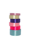 Colored ribbons. Column colored ribbons for needlework. Isolated Royalty Free Stock Photos