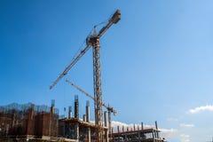 Column crane building a house. Single tower column crane building a house at construction site Stock Image