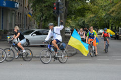Column of cyclists with Ukrainian flags. In Dnepropetrovsk, 23 August, celebrate Flag Day. All residents are located on street with yellow-blue flag of Ukraine Stock Image