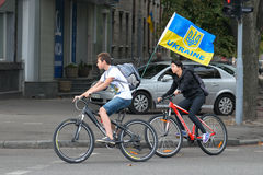 Column of cyclists with Ukrainian flags. In Dnepropetrovsk, 23 August, celebrate Flag Day. All residents are located on street with yellow-blue flag of Ukraine Stock Photo