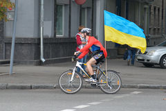 Column of cyclists with Ukrainian flags. In Dnepropetrovsk, 23 August, celebrate Flag Day. All residents are located on street with yellow-blue flag of Ukraine Royalty Free Stock Photo