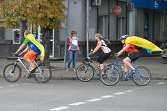 Column of cyclists with Ukrainian flags. In Dnepropetrovsk, 23 August, celebrate Flag Day. All residents are located on street with yellow-blue flag of Ukraine Royalty Free Stock Image