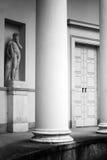 Column, door and statue Stock Image