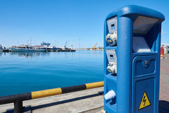 Column with electrical power for yachts and boats on docks Stock Images