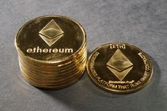 Column of ethereum with one single coin next to them Royalty Free Stock Photography