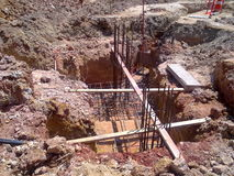 Column Foundation. Column base construction re-bars, stir-ups, and profile boards Stock Photography