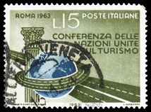 Column, globe and highway, United Nations Tourism Conference serie, circa 1963. MOSCOW, RUSSIA - FEBRUARY 22, 2019: A stamp printed in Italy shows Column, globe stock photo