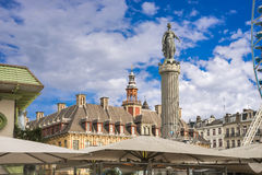 Column of the Goddess, Grand′ Place, Lille, France. Column of the Goddess - Memorial of the Siege of 1792 in the center square Grand′ Place of Lille royalty free stock images