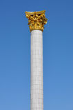 Column with a gold ornament Royalty Free Stock Photo