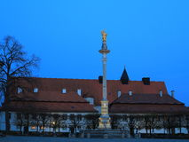 Column with gold statue at twilight Stock Photo