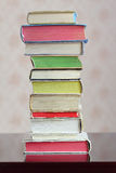 A column of hardback colorful closed books Stock Images