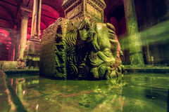 Column with inverted Medusa head. The Column with inverted Medusa head base in Basilica Cistern. Istanbul. Turkey Stock Image