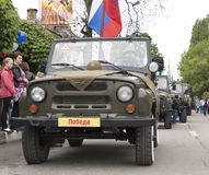 Column of military cars with veterans onboard on parade in honor. Of the 69th anniversary of the Great Victory in the Second World War. Pyatigorsk, Russia Stock Photo