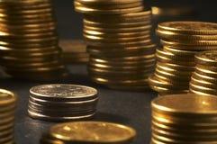Column from money. Over black stock photo