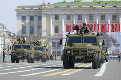 Column multi-purpose armored vehicles Tigr on rehearsal of parade in honor of Victory Day. St. Petersburg Stock Photo