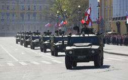 Column multipurpose cars `Tiger` in the parade in honor of Victory day. Saint Petersburg. SAINT PETERSBURG, RUSSIA - MAY 09, 2015: Column multipurpose cars ` Stock Images