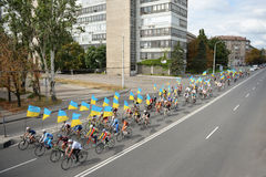 Column ofvc cyclists with Ukrainian flags. In Dnepropetrovsk, 23 August, celebrate Flag Day. All residents are located on street with yellow-blue flag of Ukraine Stock Photos