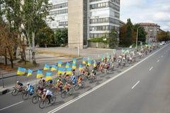 Column ofvc cyclists with Ukrainian flags Stock Photos