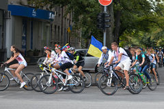 Column ofvc cyclists with Ukrainian flags. In Dnepropetrovsk, 23 August, celebrate Flag Day. All residents are located on street with yellow-blue flag of Ukraine Stock Images