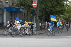 Column ofvc cyclists with Ukrainian flags. In Dnepropetrovsk, 23 August, celebrate Flag Day. All residents are located on street with yellow-blue flag of Ukraine Stock Image