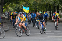 Column ofvc cyclists with Ukrainian flags. In Dnepropetrovsk, 23 August, celebrate Flag Day. All residents are located on street with yellow-blue flag of Ukraine Royalty Free Stock Image