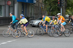 Column ofvc cyclists with Ukrainian flags. In Dnepropetrovsk, 23 August, celebrate Flag Day. All residents are located on street with yellow-blue flag of Ukraine Royalty Free Stock Images