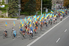 Column ofvc cyclists with Ukrainian flags. In Dnepropetrovsk, 23 August, celebrate Flag Day. All residents are located on street with yellow-blue flag of Ukraine Royalty Free Stock Photography