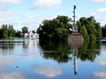 Column and Pavilion on lake in Pushkin park Royalty Free Stock Photography