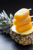 Column of pineapple sorbet ice cream popsicles. Royalty Free Stock Image