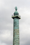 Column at the Place Vendome. In Paris was erected by the order of Napoleon Bonaparte Royalty Free Stock Photo