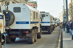 Column of police trucks for arresting people driving along Tverskaya street Royalty Free Stock Photography