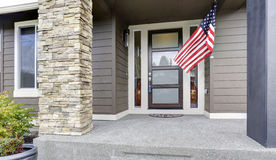 Column porch of luxurious house with American flag. Northwest, USA Royalty Free Stock Photo