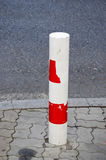 Column prevents car to pass road prohibited area. Royalty Free Stock Photo