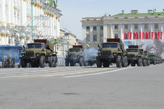 A column of reactive multiple rocket launchers BM-21-1 Grad on Palace square. Rehearsal of parade in honor of Victory Stock Photos