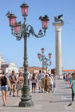 Column of San Marco in Venice. With ornamental lamps Royalty Free Stock Image