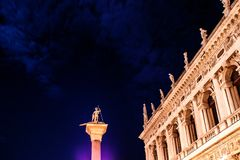 Column of St. Theodore, under the stars. Night view of Piazza San Marco, Venice, Italy Stock Photos
