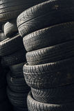 Column stack of old used car tires Stock Images