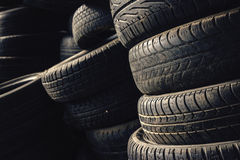 Column stack of old used car tires Stock Photography