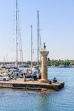 Column with a statue of a deer. Port of Mandraki Rhodes Royalty Free Stock Photography