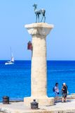 Column with a statue of a deer.  Port of Mandraki. Rhodes Island. Greece Stock Photography