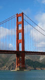 Golden Gate Bridge Tower Support. Bright red of the bridge support stands in stark contrast with the vivid blue sky Royalty Free Stock Image