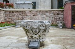 A column of the 7th century Byzantium Period. Istanbul,TURKEY-April 21,2015: A column of the 7th century Byzantium Period in the Hagia Sophia Museum Courtyard royalty free stock images