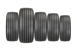 Column of tires isolated on the white stock photos