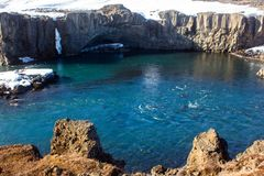 Columnar basalt formation over turquoise water. With sunny weather in iceland royalty free stock photos