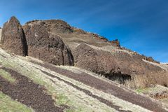 Columnar Basalt Rocks. Form a steep hillside with erosion creating falling gravel in Lyons Ferry State Park in Eastern Washington royalty free stock photo